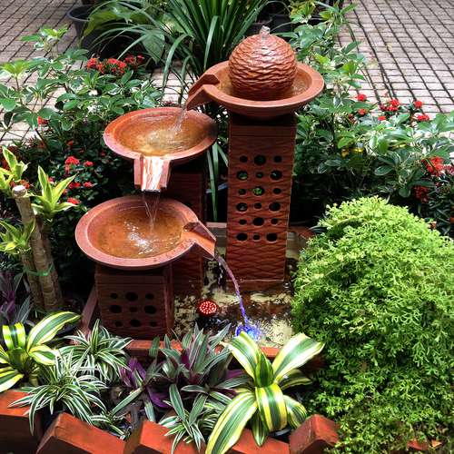 add a water feature to outdoor landscaping design