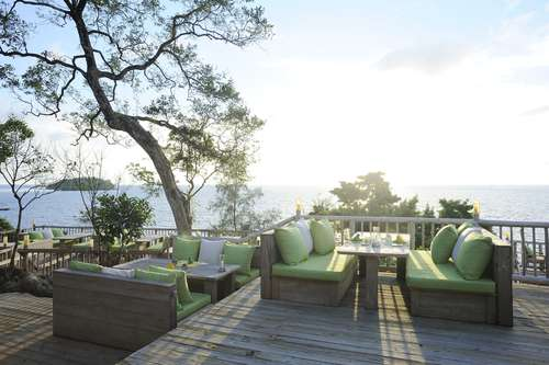 add outdoor living furniture to increase landscaping design and curb appeal